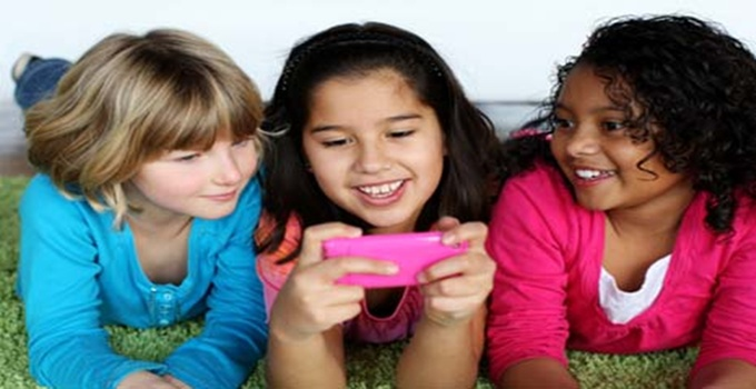 Girls playing with smartphone
